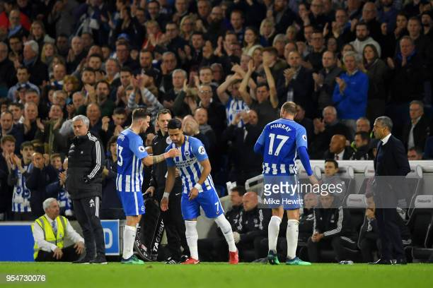 Jose Mourinho manager of Manchester United and Chris Hughton manager of Brighton Hove Albion look on as goalscorer Pascal Gross of Brighton Hove...