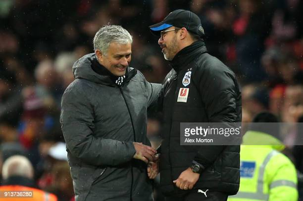 Jose Mourinho Manager of Manchester United and David Wagner Manager of Huddersfield Town embrace after the Premier League match between Manchester...