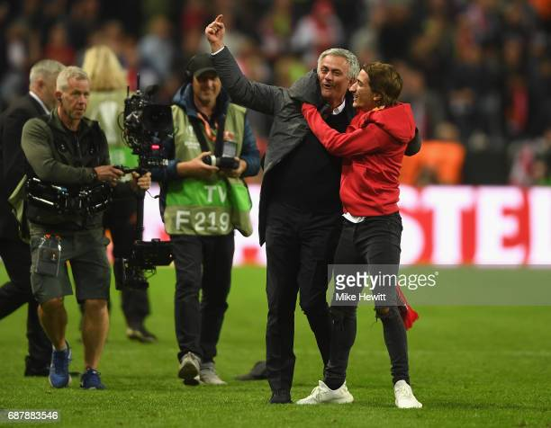 Jose Mourinho Manager of Manchester United and his son Jose Mario Mourinho JR celebrate victory following the UEFA Europa League Final between Ajax...