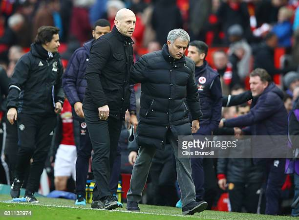 Jose Mourinho Manager of Manchester United and Jaap Stam the manager of Reading shake hands after the full time whistle in the Emirates FA Cup third...
