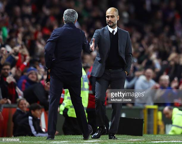 Jose Mourinho Manager of Manchester United and Josep Guardiola Manager of Manchester City shake hands after the final whistle during the EFL Cup...