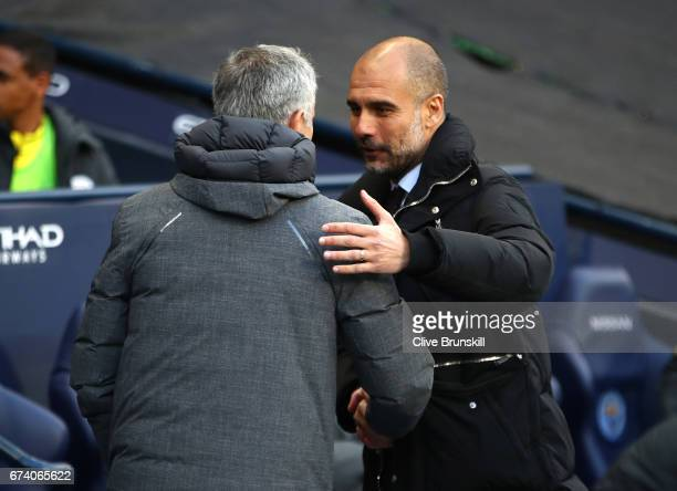 Jose Mourinho Manager of Manchester United and Josep Guardiola Manager of Manchester City shake hands before kick off during the Premier League match...