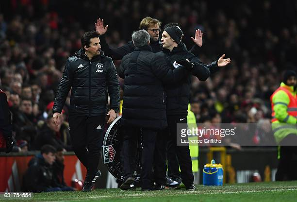 Jose Mourinho manager of Manchester United and Jurgen Klopp manager of Liverpool argue on the touchline as fourth official Craig Pawson intervenes...
