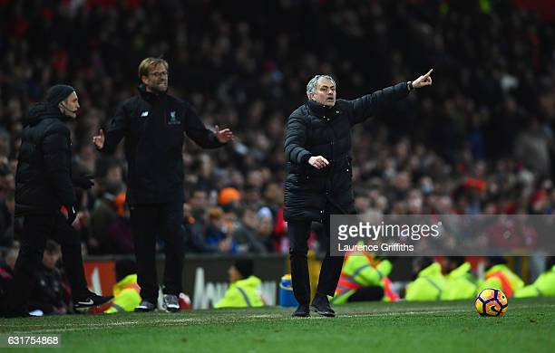Jose Mourinho manager of Manchester United and Jurgen Klopp manager of Liverpool react during the Premier League match between Manchester United and...