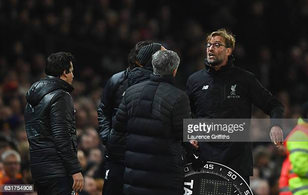 Jose Mourinho manager of Manchester United and Jurgen Klopp manager of Liverpool argue on the touchline the Premier League match between Manchester...