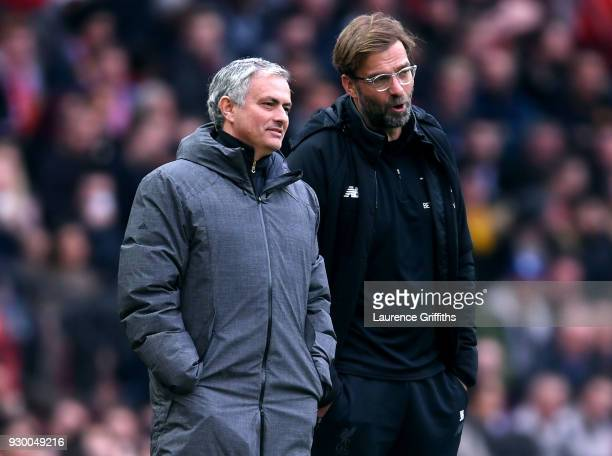 Jose Mourinho Manager of Manchester United and Jurgen Klopp Manager of Liverpool speak during the Premier League match between Manchester United and...