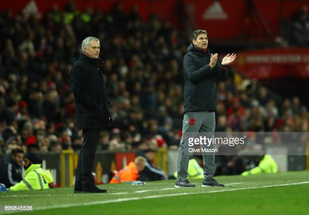 Jose Mourinho Manager of Manchester United and Mauricio Pellegrino Manager of Southampton look on from the touchline during the Premier League match...