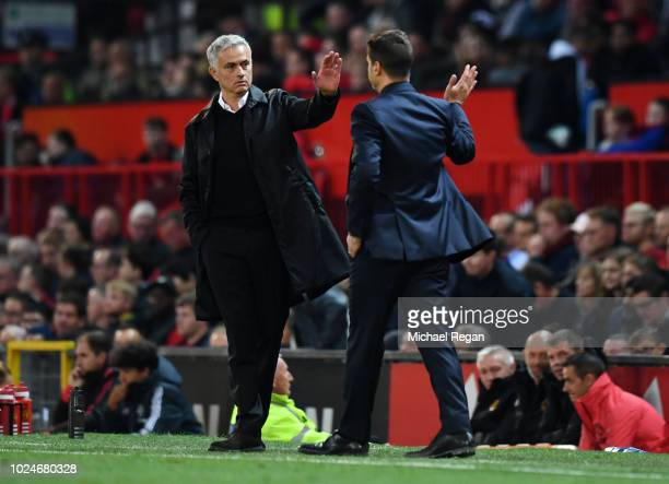 Jose Mourinho Manager of Manchester United and Mauricio Pochettino Manager of Tottenham Hotspur give each other a high five after the Premier League...