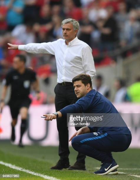 Jose Mourinho Manager of Manchester United and Mauricio Pochettino Manager of Tottenham Hotspur give their teams instruction during The Emirates FA...