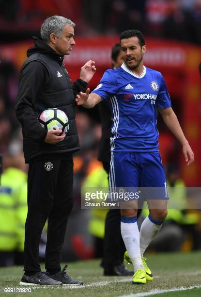 Jose Mourinho Manager of Manchester United and Pedro of Chelsea exchange words during the Premier League match between Manchester United and Chelsea...