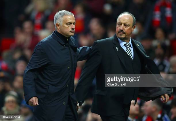 Jose Mourinho, Manager of Manchester United and Rafael Benitez, Manager of Newcastle United walk off the pitch at half time of the Premier League...