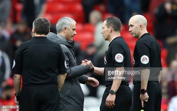 Jose Mourinho Manager of Manchester United and referee Kevin Friend embrace after the Premier League match between Manchester United and AFC...
