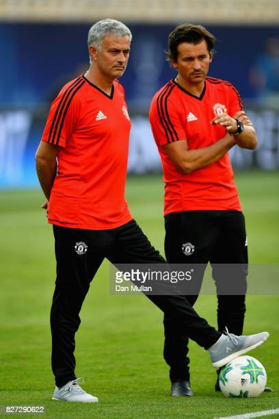 Jose Mourinho Manager of Manchester United and Rui Faria Manchester United assistant manager look on during a training session ahead of the UEFA...