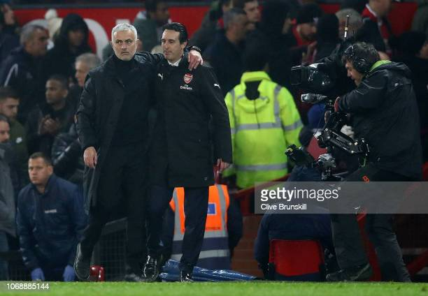 Jose Mourinho Manager of Manchester United and Unai Emery Manager of Arsenal hug each other after the Premier League match between Manchester United...