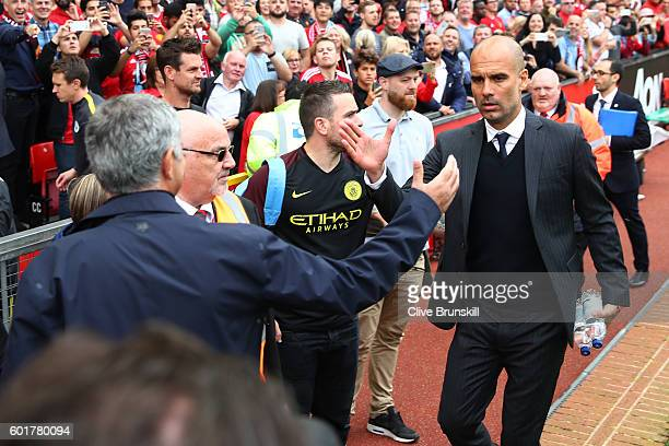Jose Mourinho Manager of Manchester United annd Josep Guardiola Manager of Manchester City shake hands before kick off during the Premier League...