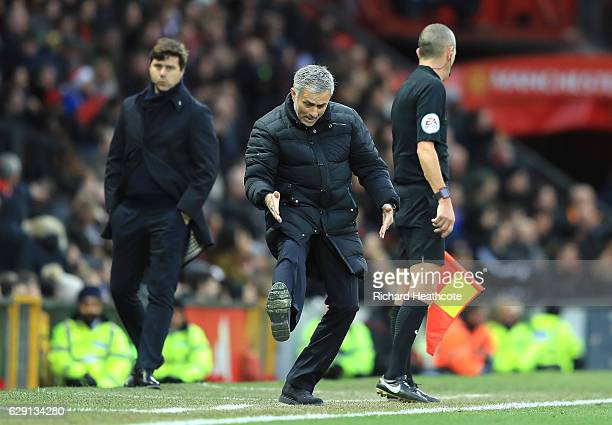 Jose Mourinho Manager of Manchester United appeals to an assistant referee during the Premier League match between Manchester United and Tottenham...