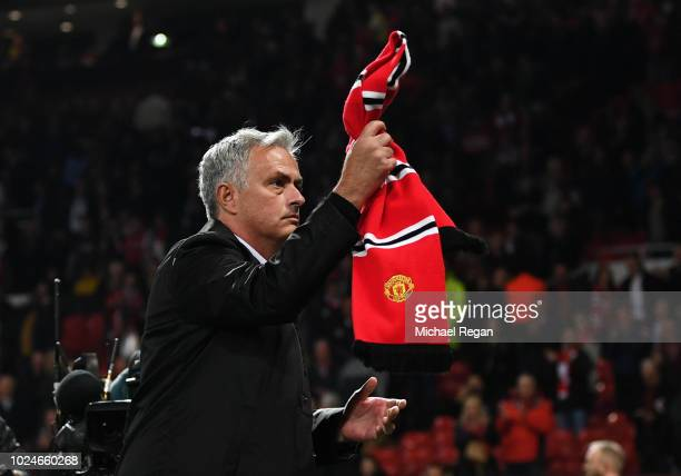 Jose Mourinho Manager of Manchester United applauds fans after the Premier League match between Manchester United and Tottenham Hotspur at Old...