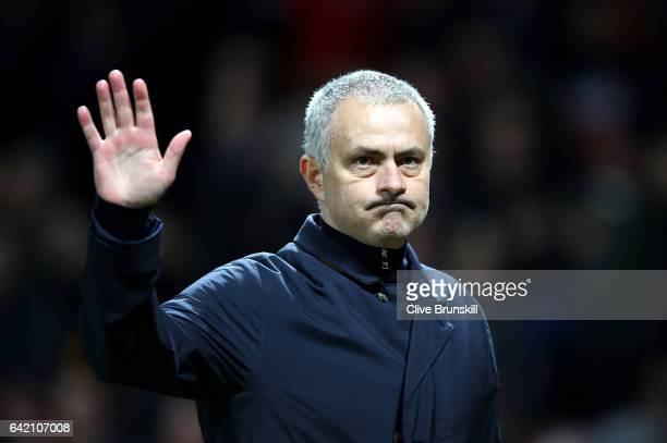 Jose Mourinho, Manager of Manchester United applauds supporters during the UEFA Europa League Round of 32 first leg match between Manchester United...