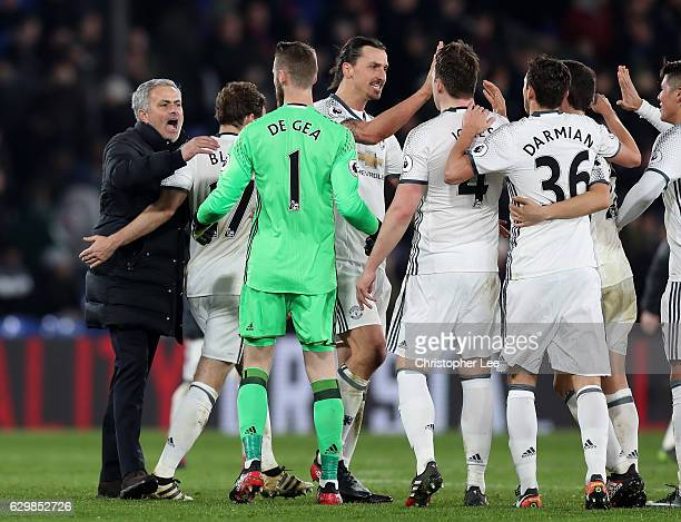 Jose Mourinho Manager of Manchester United celebrates his team's win with players after the Premier League match between Crystal Palace and...