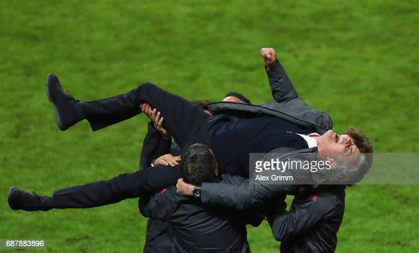 Jose Mourinho Manager of Manchester United celebrates victory with his backroom staff following the UEFA Europa League Final between Ajax and...