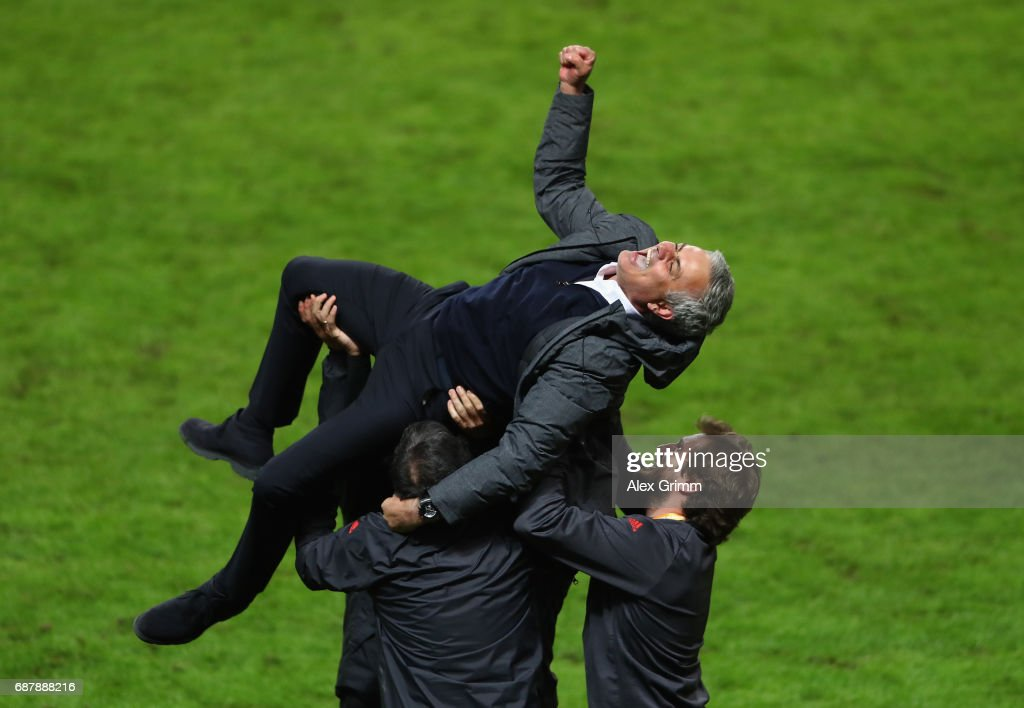 Jose Mourinho, Manager of Manchester United celebrates victory with his backroom staff following the UEFA Europa League Final between Ajax and Manchester United at Friends Arena on May 24, 2017 in Stockholm, Sweden.