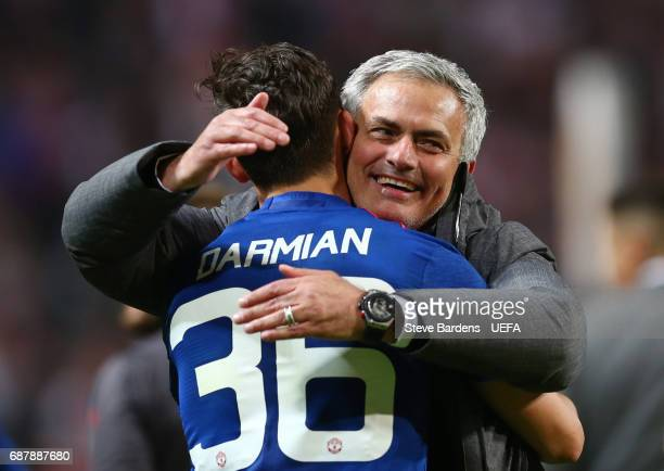 Jose Mourinho Manager of Manchester United celebrates with Matteo Darmian of Manchester United following victory in the UEFA Europa League Final...