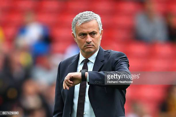 Jose Mourinho Manager of Manchester United checks his watch as it approaches kick off during the Premier League match between Watford and Manchester...