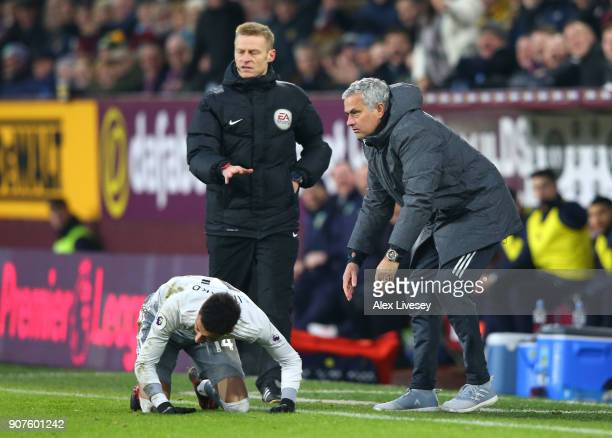Jose Mourinho Manager of Manchester United checks that Jesse Lingard of Manchester United is ok during the Premier League match between Burnley and...