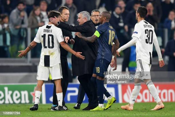 Jose Mourinho Manager of Manchester United confronts Paulo Dybala of Juventus as Ashley Young of Manchester United holds him back during the UEFA...