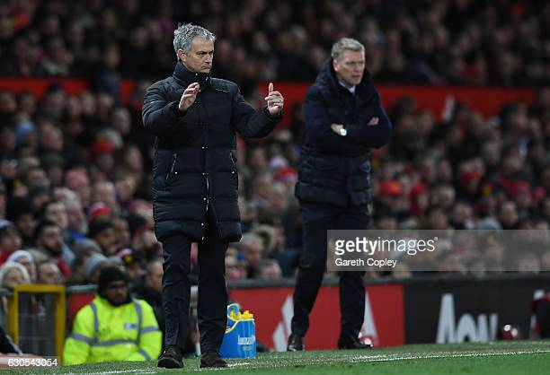 Jose Mourinho Manager of Manchester United directs his players as David Moyes Manager of Sunderland looks on during the Premier League match between...