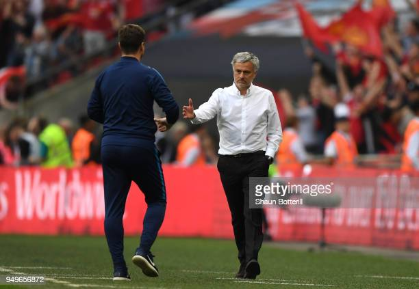 Jose Mourinho Manager of Manchester United embraces Mauricio Pochettino Manager of Tottenham Hotspur after The Emirates FA Cup Semi Final match...