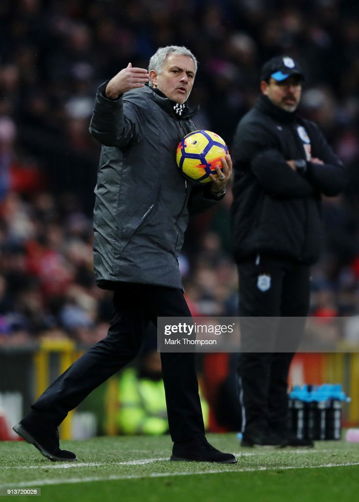 Jose Mourinho, Manager of Manchester United gives his team instructions during the Premier League match between Manchester United and Huddersfield Town at Old Trafford on February 3, 2018 in Manchester, England.