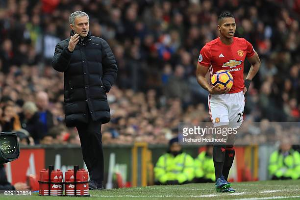 Jose Mourinho Manager of Manchester United gives instruction to Antonio Valencia during the Premier League match between Manchester United and...