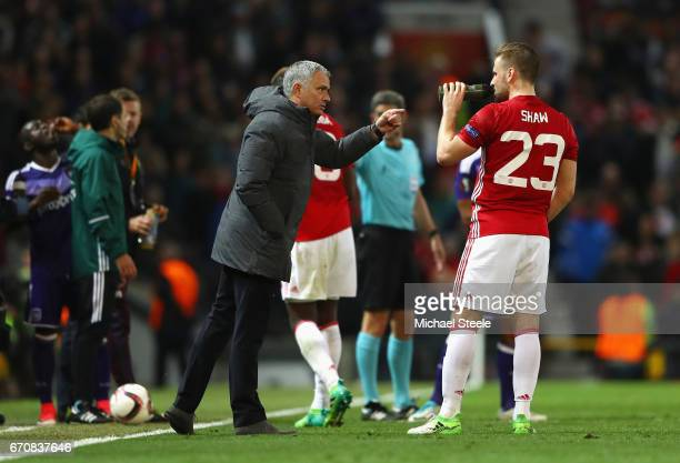 Jose Mourinho manager of Manchester United gives Luke Shaw of Manchester United instructions during the UEFA Europa League quarter final second leg...