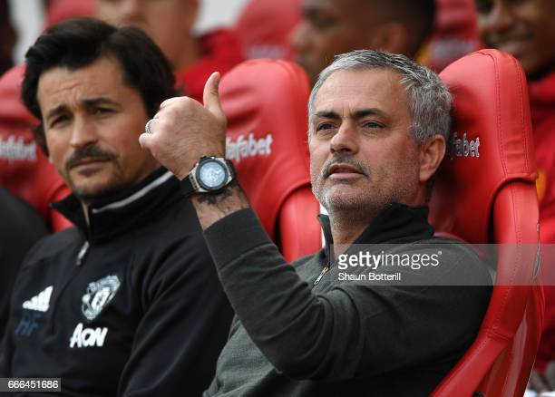Jose Mourinho Manager of Manchester United gives the thumbs up with assistant Rui Faria during the Premier League match between Sunderland and...