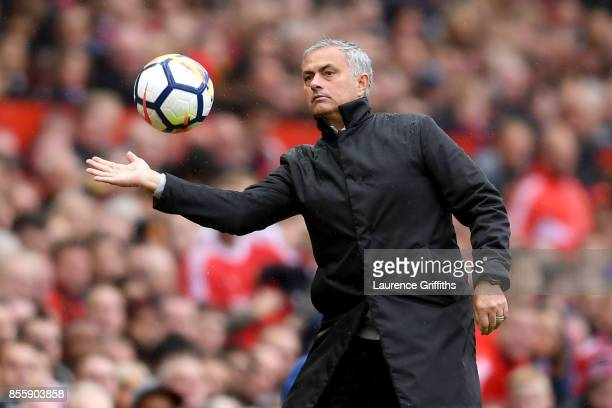 Jose Mourinho Manager of Manchester United handles the ball during the Premier League match between Manchester United and Crystal Palace at Old...