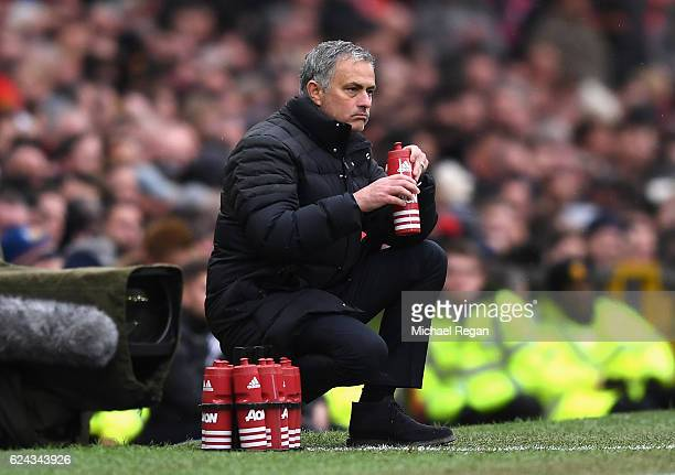 Jose Mourinho Manager of Manchester United has a drink during the Premier League match between Manchester United and Arsenal at Old Trafford on...