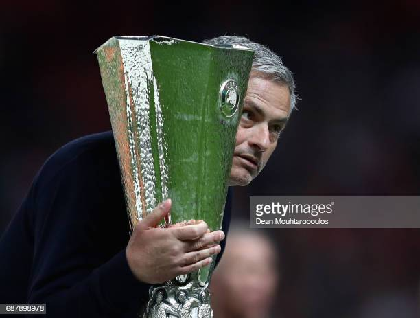 Jose Mourinho, Manager of Manchester United holds the trophy following victory in the UEFA Europa League Final between Ajax and Manchester United at...