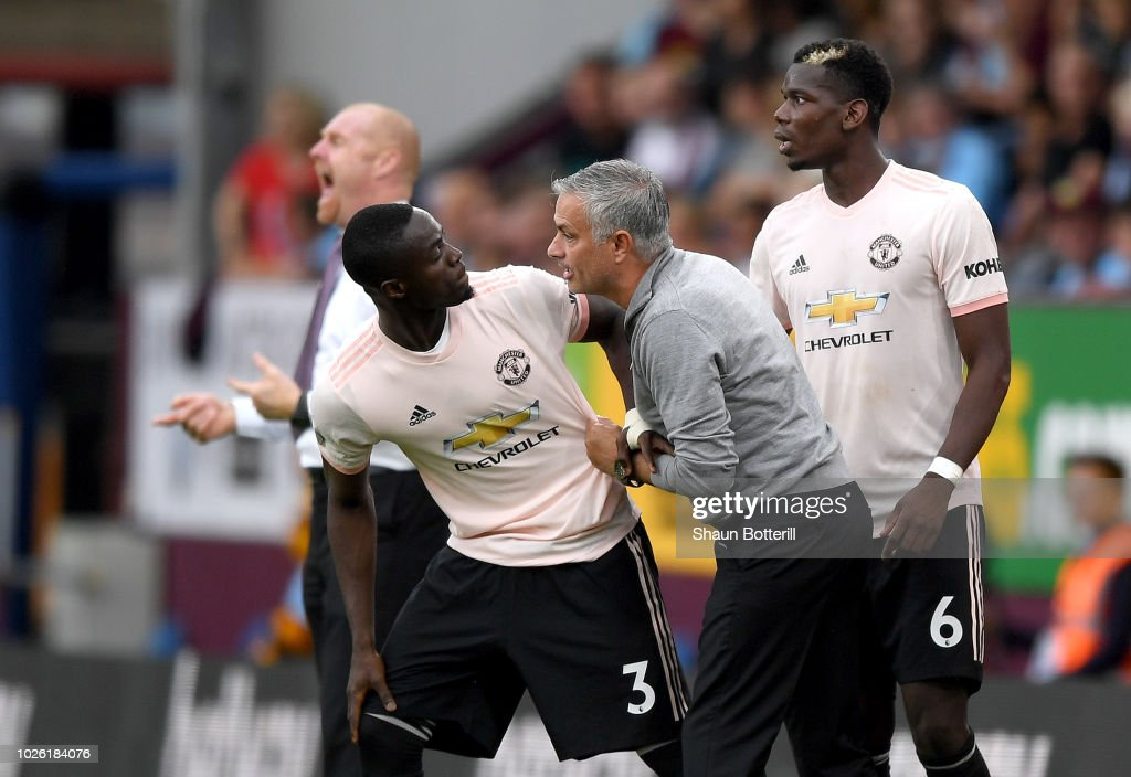 Jose Mourinho, Manager of Manchester United in discussion with Eric Bailly of Manchester United during the Premier League match between Burnley FC and Manchester United at Turf Moor on September 2, 2018 in Burnley, United Kingdom.
