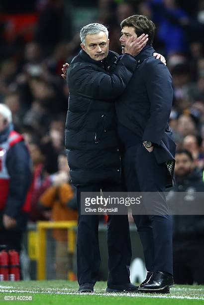 Jose Mourinho Manager of Manchester United is congratulated by Mauricio Pochettino Manager of Tottenham Hotspur after his team's 10 win in the...