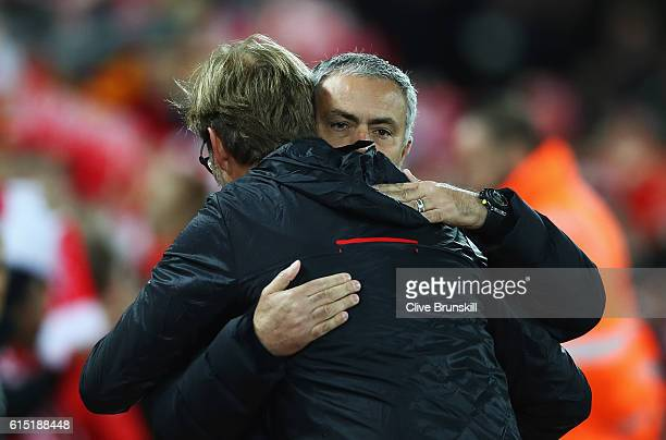 Jose Mourinho Manager of Manchester United is greeted by Jurgen Klopp Manager of Liverpool during the Premier League match between Liverpool and...