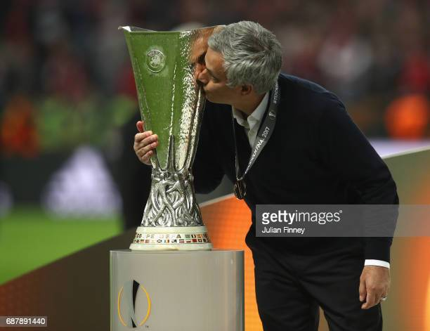 Jose Mourinho Manager of Manchester United kisses the trophy following victory in the UEFA Europa League Final between Ajax and Manchester United at...