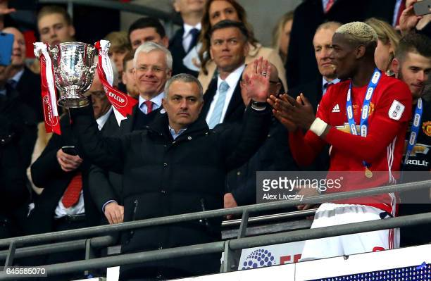 Jose Mourinho manager of Manchester United lifts the trophy in victory alongside Paul Pogba after during the EFL Cup Final between Manchester United...