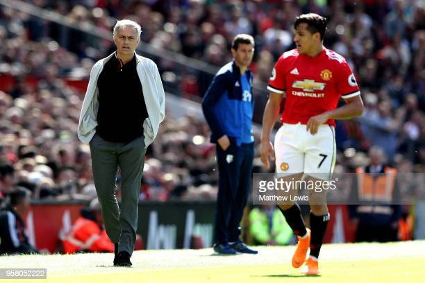 Jose Mourinho Manager of Manchester United looks on as Alexis Sanchez of Manchester United looks on during the Premier League match between...