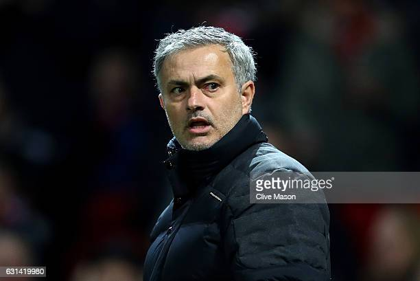 Jose Mourinho Manager of Manchester United looks on during the EFL Cup SemiFinal First Leg match between Manchester United and Hull City at Old...
