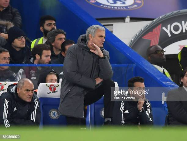 Jose Mourinho Manager of Manchester United looks on during the Premier League match between Chelsea and Manchester United at Stamford Bridge on...