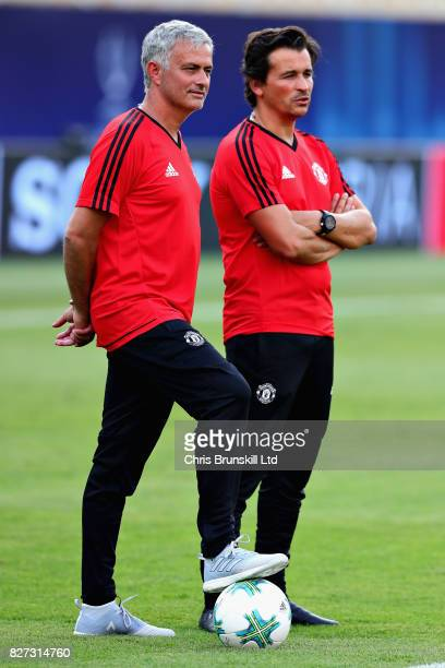 Jose Mourinho Manager of Manchester United looks on with assistant Rui Faria during a training session ahead of the UEFA Super Cup at the National...