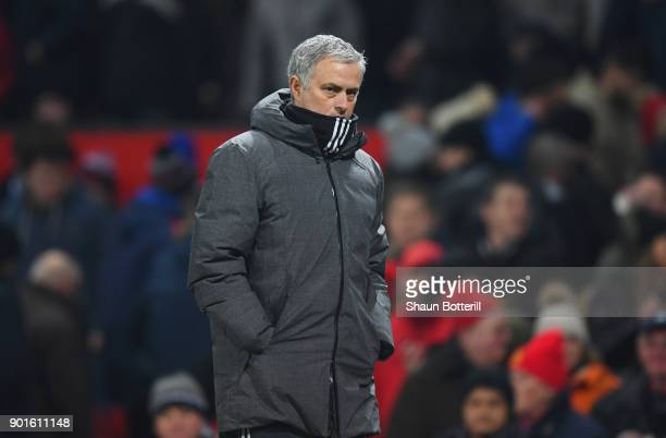 Jose Mourinho Manager of Manchester United looks thoughtful at half time during the Emirates FA Cup Third Round match between Manchester United and...