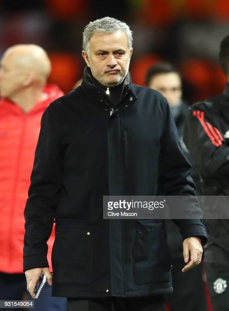 Jose Mourinho Manager of Manchester United looks thoughtful at half time during the UEFA Champions League Round of 16 Second Leg match between...
