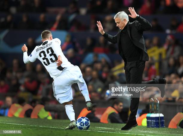 Jose Mourinho, Manager of Manchester United moves back as Federico Bernardeschi of Juventus runs with the ball towards him during the Group H match...